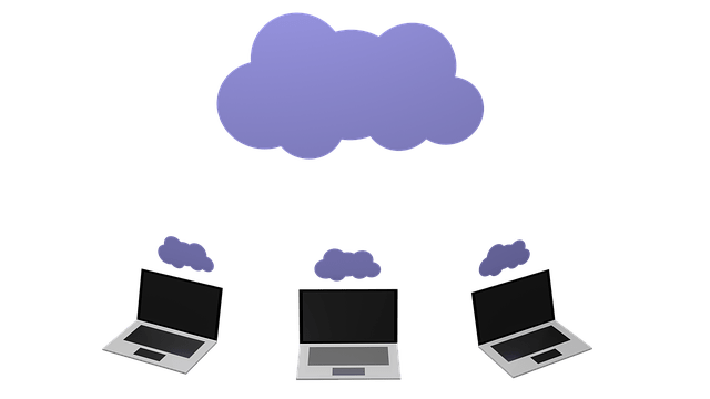 a image showing 3 laptops and cloud