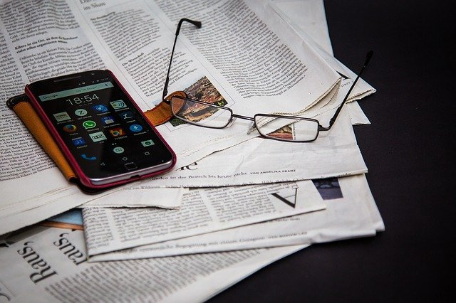 an image showing paper, mobile and eye glass